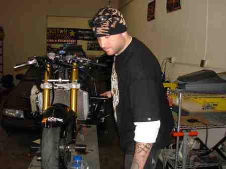 JOSH GETTING MY BIKE READY FOR PRACTICE.
